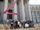 This image is of Pam Hutton at the capitol steps at a podium for the 2010 Click It or Ticket Campaign thumbnail image