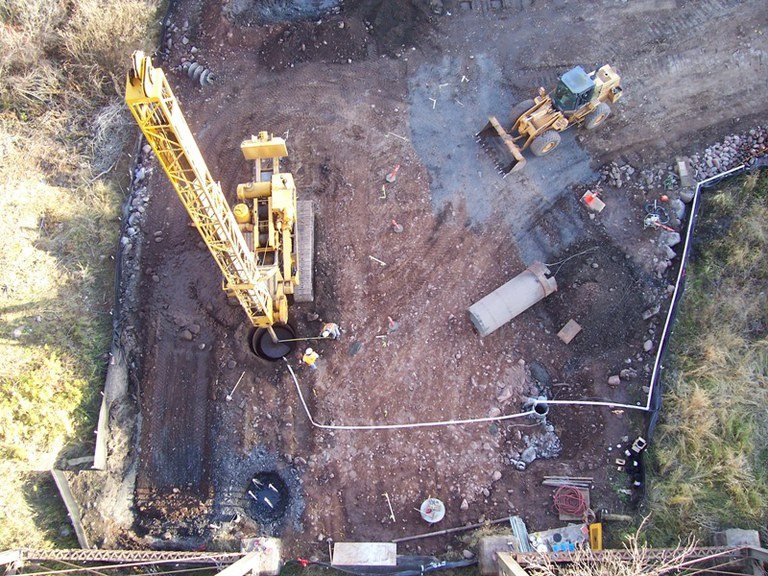 View from the old bridge looking down on the new caisson foundations being drilled.