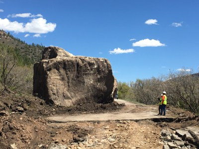 CDOT geo-technical personnel believe a large outcropping from the ridgeline above the highway broke into two large pieces as it rolled down the slope to CO 145.