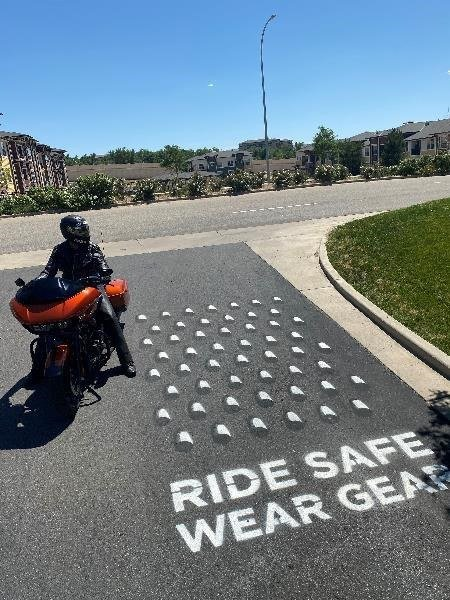 Human Cheese Grater image on roadway
