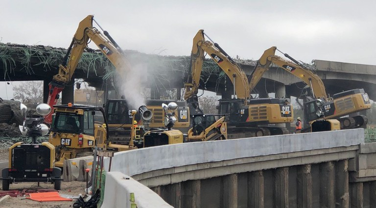 Misting cannons in use on Saturday, May 22, 2021, to wet dust to prevent it from spreading throughout the air during the demolition of the I-70 viaduct