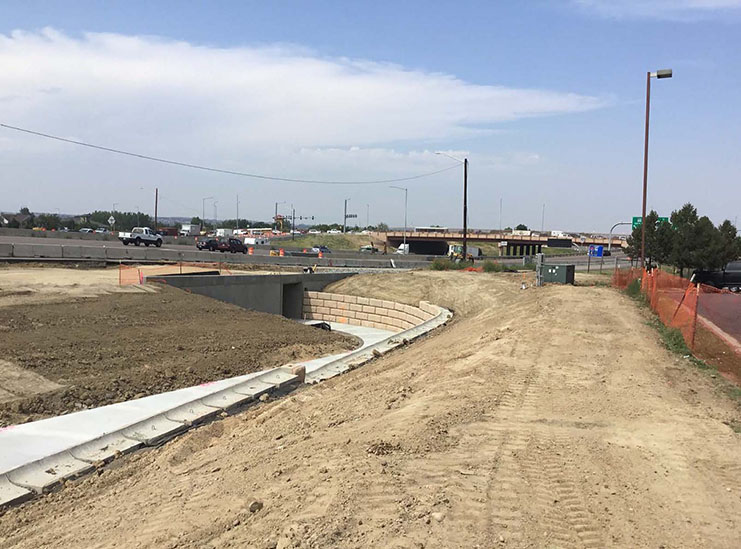 Pedestrian/Bike path and wall westbound leading to pedestrian tunnel under I-25