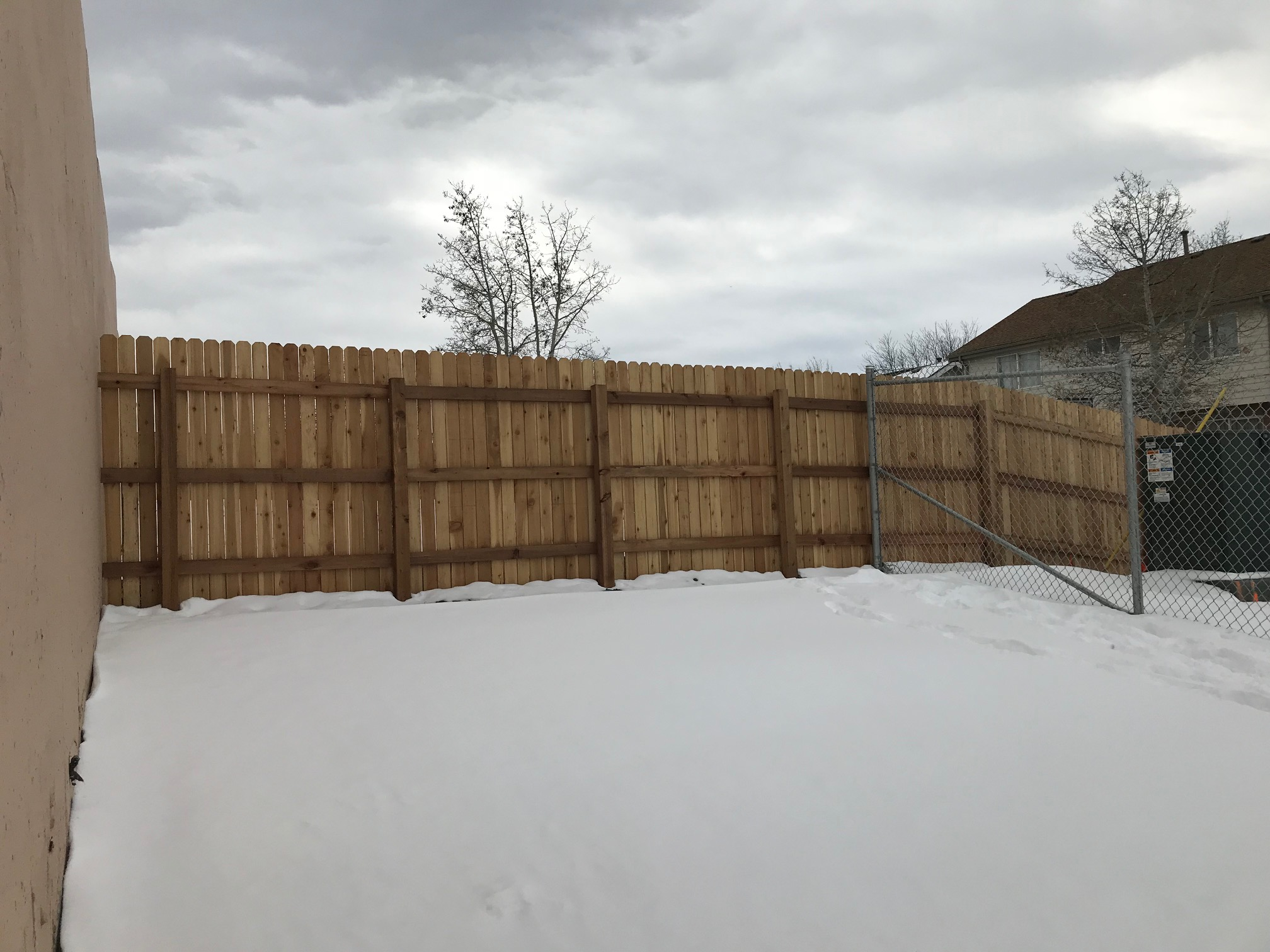 New Backyard Fence for Acoma Street Residents