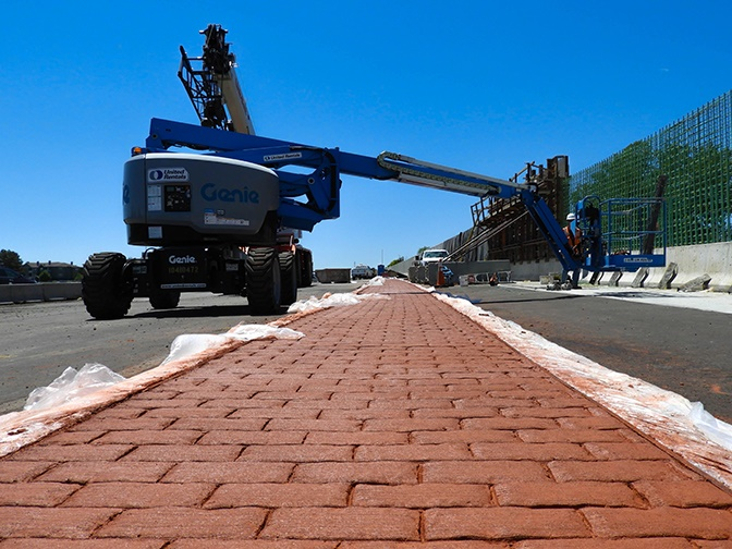 Pouring of concrete median cover on SB I-25 on ramp at 120th Avenue detail image