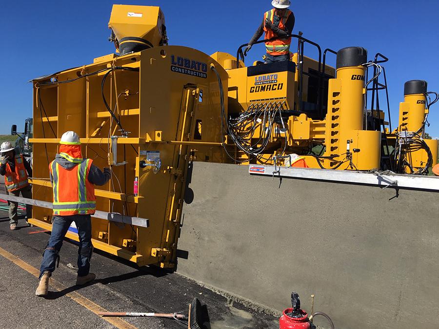 Crews slip forming barrier