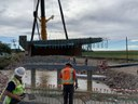 crews preparing to lower deck onto bridge superstructure.jpg