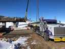 Crews unloading girders for placement northbound bridge thumbnail image