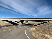 Wide view of finished northbound bridge at I-25 Exit 59 over CR 103.