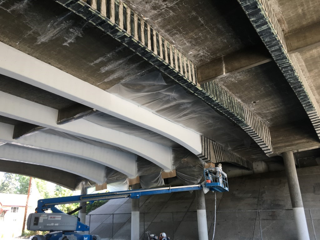 Crews paint the Tennyson Street Bridge