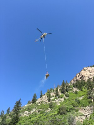 Helicopter operations deliver materials to the rockfall fence building site June 1, 2016.