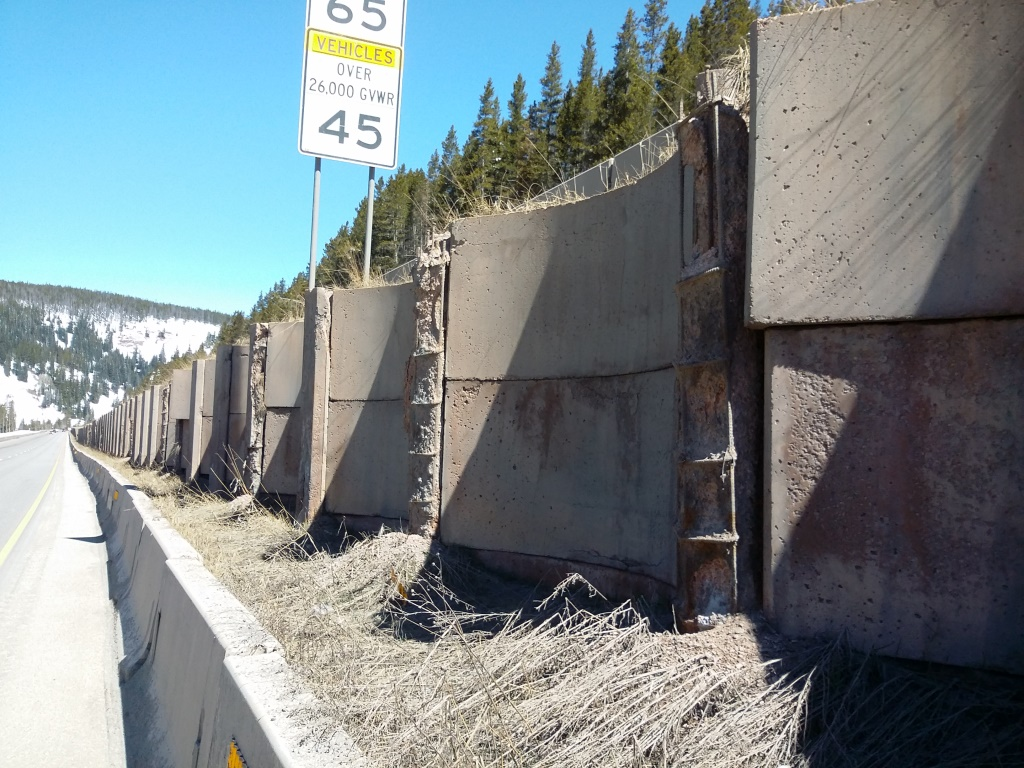 Heavy freeze thaw damage on vertical copings from west end of wall.JPG
