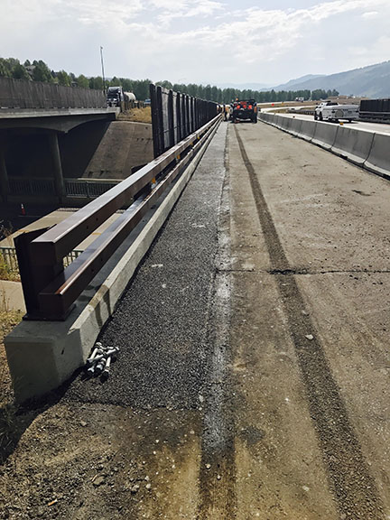 the installation of bridge rail with fencing already installed. This is north side of F-10-R on I-70 EB.