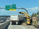 Crews clearing and loading for auxiliary lane Phase 1.jpg thumbnail image