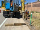 Crews installing timber barrier.jpg thumbnail image