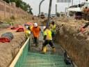 Crews pumping concrete new retention pond I-225.jpg thumbnail image