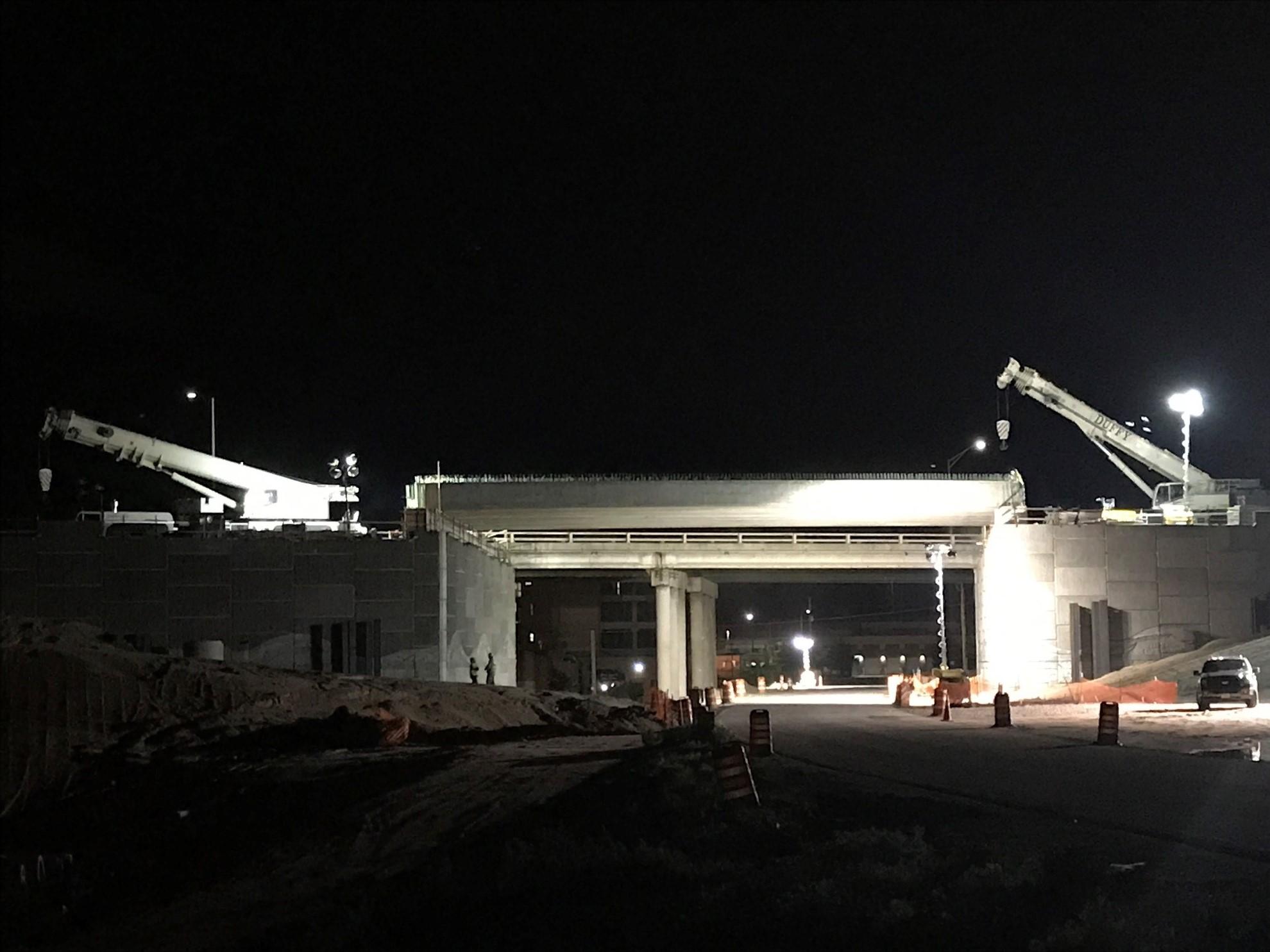 Cranes setting girders on Gruma Bridge
