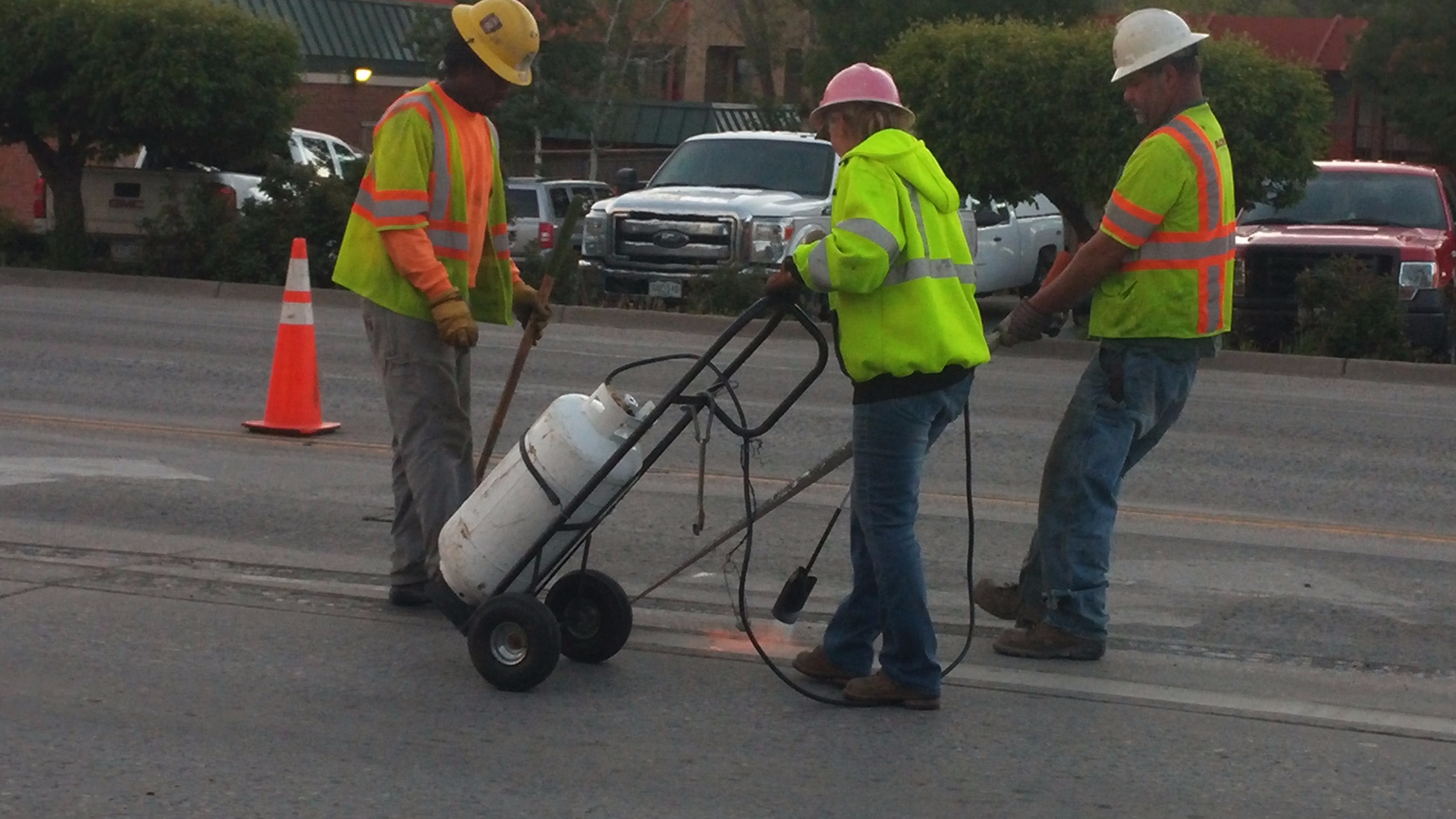 Crews removing epoxy striping at US 550 and College Avenue.jpg
