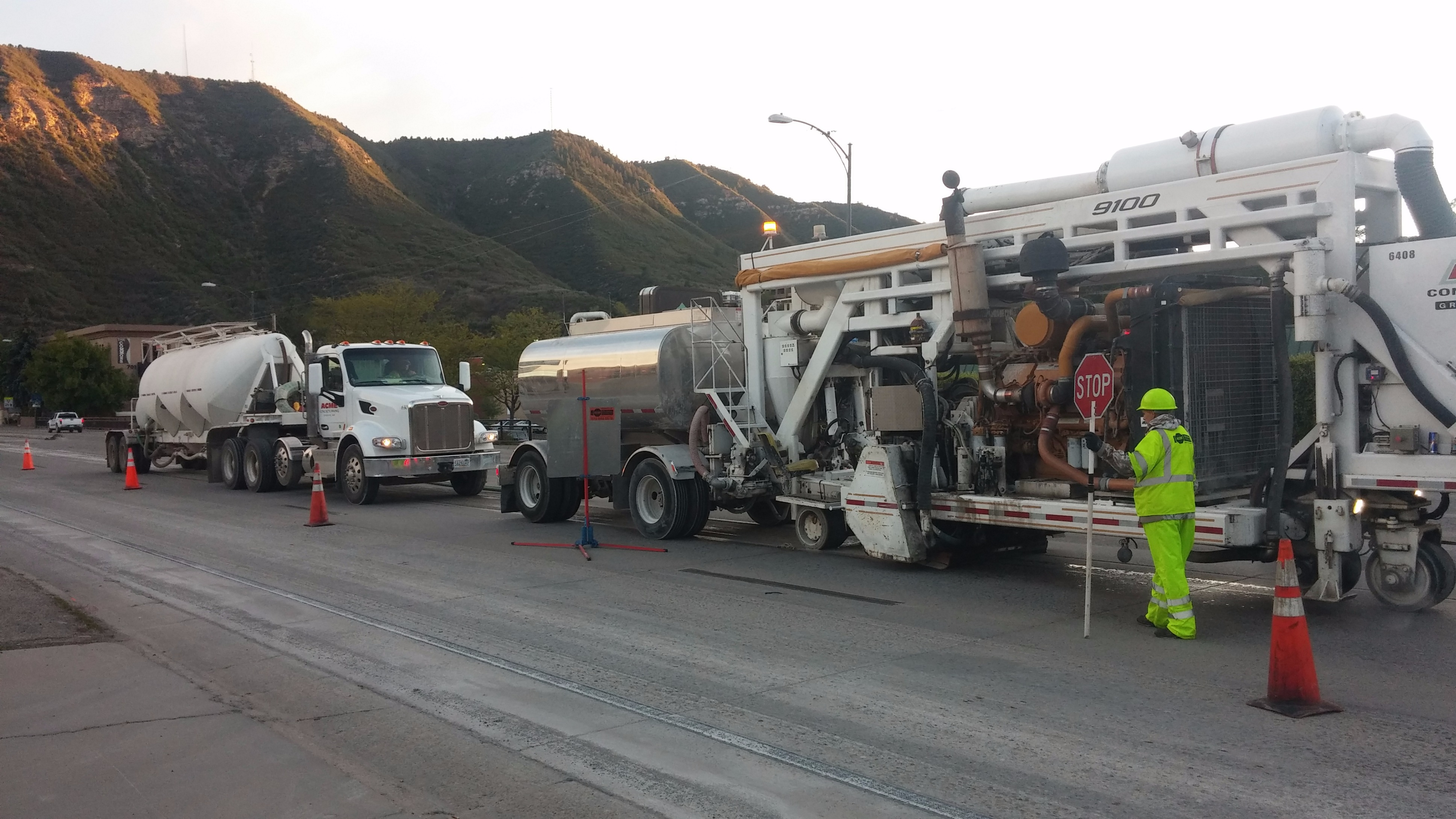 Two diamond grinding trucks at US 550 and College Avenue.jpg