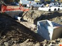 An inlet and pipe being set for storm water run off. thumbnail image