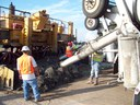 Crews pave the new roundabouts on 96th Avenue. thumbnail image