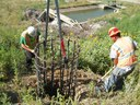 Crews prepare the area for the new traffic signals at this interchange. During Construction. thumbnail image