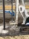 closeup crews pre drilling abutment piles.jpg thumbnail image