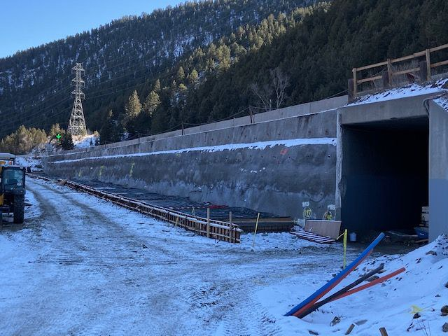 Wide shot box culvert extension and wall