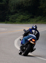 Motorcyclist on the highway thumbnail image