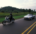 Motorcycle and car on the highway; used for share the road/watch out for motorcycle tips. thumbnail image
