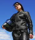 Photo of motorcyclist wearing leather gear and holding a helmet. thumbnail image