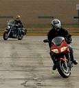Riding instruction class with riders navigating cones thumbnail image